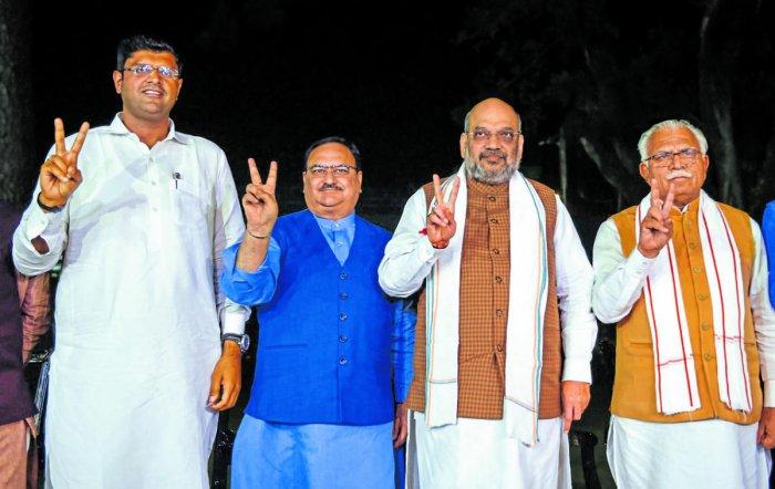 Home Minister Amit Shah, BJP Working President JP Nadda, Haryana Chief Minister Manohar Lal Khattar, JJP leader Dushyant Chautala. PTI Photo
