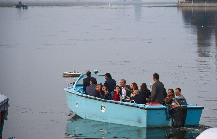 Members of European Union Parliamentary delegation during a boat ride at Dal Lake in Srinagar (PTI Photo)