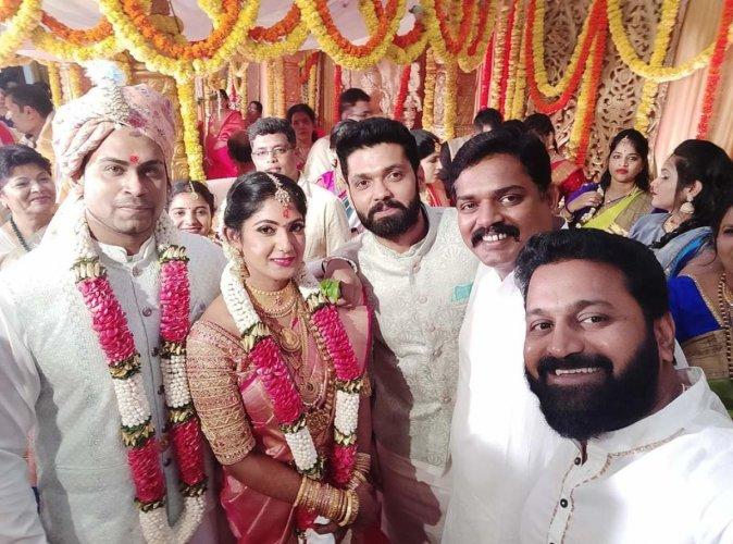 Sandalwood actor Yagna Shetty with her husband Sandeep Shetty poses for a photo with film actors Rakshith Shetty, Pramod Shetty and Rishab Shetty on Wednesday.