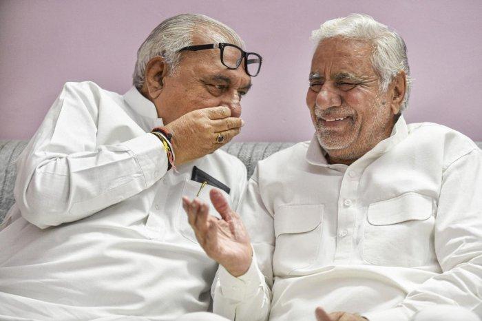 Haryana's former chief minister and senior Congress leader Bhupinder Singh Hooda with party leader Raghuvir Singh Kadian. (PTI File Photo)