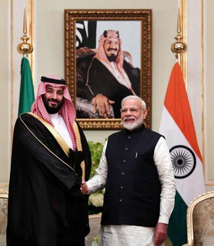 Prime Minister Narendra Modi and Saudi Arabia's Crown Prince Mohammed bin Salman shaking hands in Riyadh. (Photo by Handout / PIB / AFP)