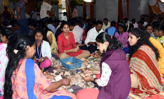 Bank employees count the offerings at Hasanamba temple in Hassan on Wednesday. dh photo