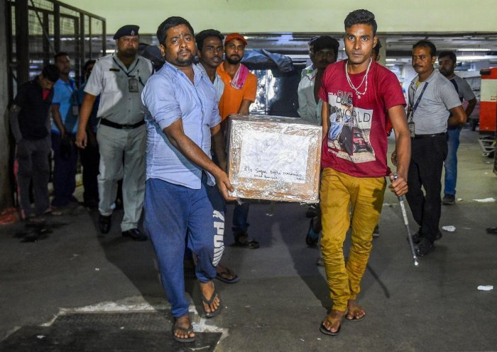 Coffins containing bodies of the five labourers from Murshidabad district of West Bengal, who were allegedly killed in a militant attack in south Kashmir's Kulgam district, arrive at NSCBI Airport in Kolkata, Wednesday, Oct. 30, 2019. (PTI Photo)