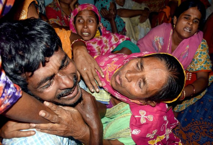 Family members of labourers, who were shot dead by terrorists in Jammu and Kashmir's Kulgam, mourn as bodies of those killed arrive at their village in Murshidabad district of West Bengal, Thursday, Oct. 31, 2019. (PTI Photo)