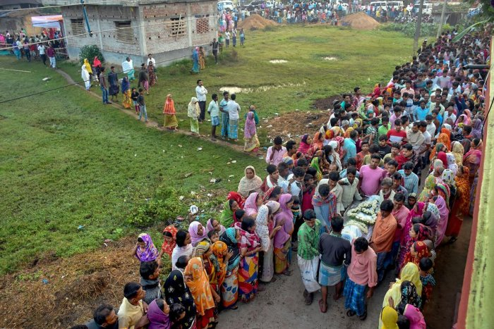 Villagers gather as bodies of five labourers, who were killed in a militant attack in south Kashmir's Kulgam district, are brought at Bahelnagar village in Murshidabad district of West Bengal on Thursday. (PTI Photo)