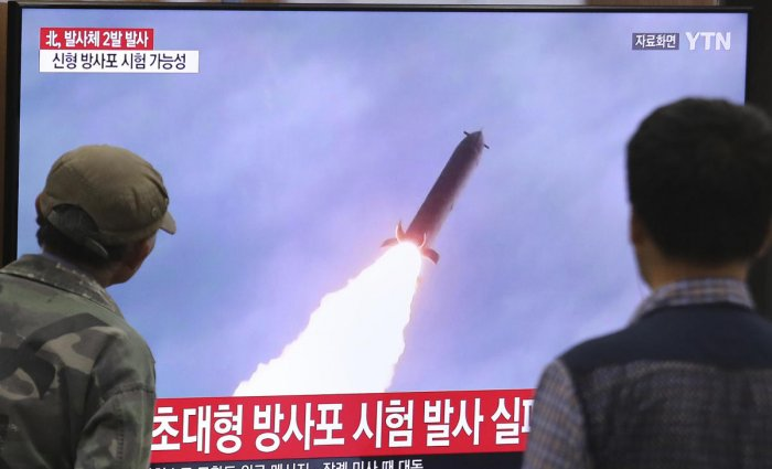 People watch a TV showing a file image of an unspecified North Korea's missile launch during a news program at the Seoul Railway Station in Seoul, South Korea, Thursday, Oct. 31, 2019. (AP/PTI)