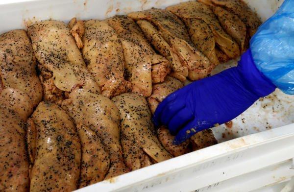 n employee prepares foie gras (duck liver) at the Maison Lafitte company factory in Montaut. (Reuters photo)
