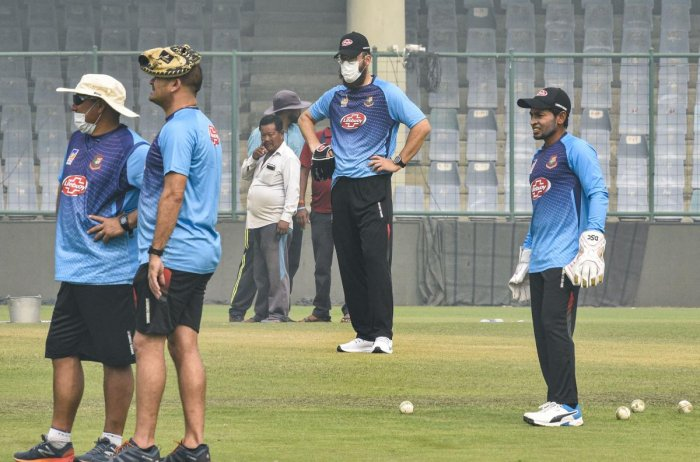 Bangladeshi cricketer Mushfiqur Rahim with coach Daniel Vettori and other support staff members during a practice session at Arun Jaitley Stadium in New Delhi, Friday, Nov. 1, 2019. PTI Photo