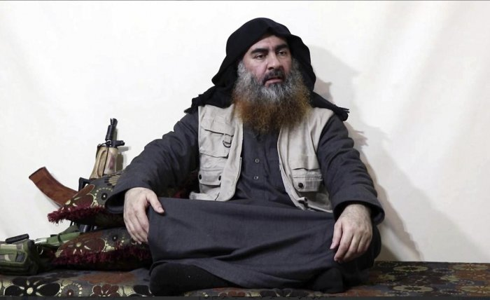 This file image made from video posted on a militant website April 29, 2019, purports to show the leader of the Islamic State group, Abu Bakr al-Baghdadi, being interviewed by his group's Al-Furqan media outlet