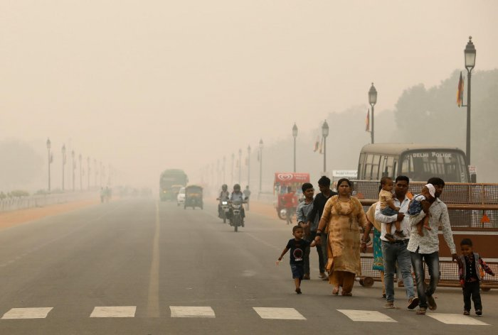People walk on the Rajpath on a smoggy day in New Delhi, India. Reuters