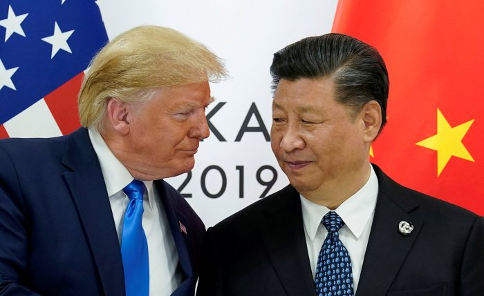 US President Donald Trump meets with China's President Xi Jinping. (Reuters Photo)