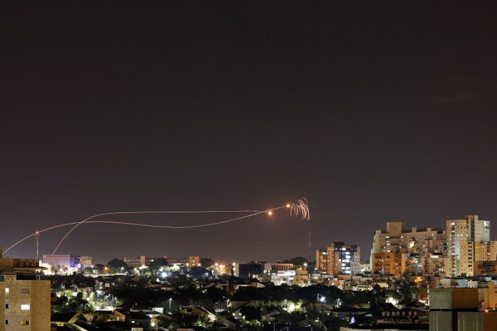 Iron Dome anti-missile system fires interception missiles as rockets are launched from Gaza towards Israel as seen from the city of Ashkelon, Israel Ashkelon. (Reuters Photo)