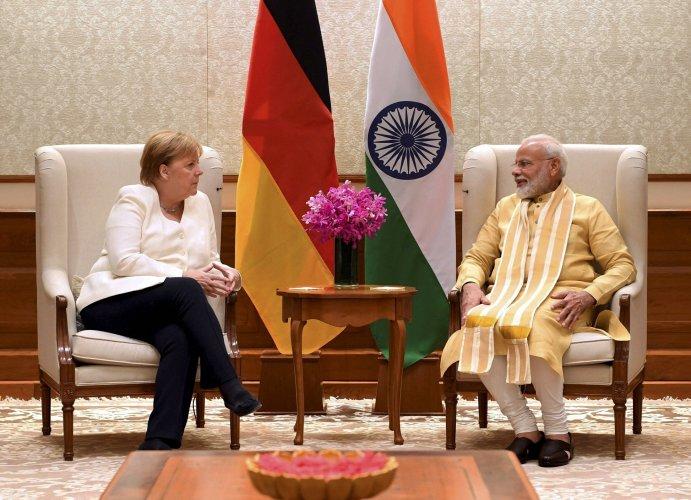 Prime Minister Narendra Modi with German Chancellor Angela Merkel at Lok Kalyan Marg in New Delhi. (PTI Photo)