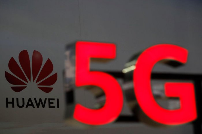 Huawei and 5G signs are on display (AFP Photo)