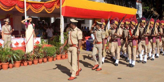 Deputy Commissioner Annies Kanmani Joy receives guard of honour from Police Squad during Karnataka Rajyotsava celebrations in Madikeri on Friday.