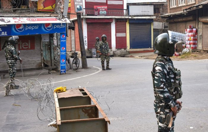 Security personnel stand guard during restrictions in the parts of Downtown in Srinagar, Friday, Nov. 1, 2019. PTI