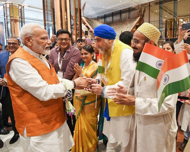 Prime Minister Narendra Modi being welcomed by Indian community, in Bangkok, Thailand on Saturday. (PTI Photo)