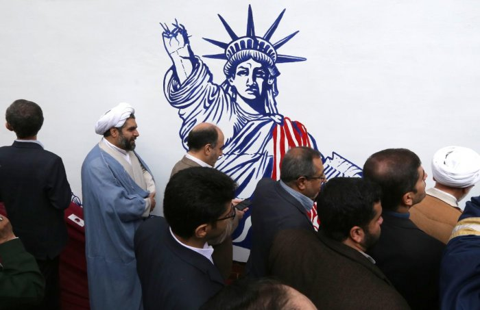 Iranians take part in an inaugural ceremony unveiling the new murals painted on the walls of the former US embassy in the capital Tehran on November 2, 2019. AFP