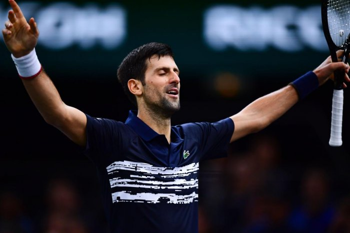 Serbia's Novak Djokovic celebrates winning a point against Bulgaria's Grigor Dimitrov during their men's singles semi-final tennis match at the ATP World Tour Masters 1000 - Rolex Paris Masters - indoor tennis tournament at The AccorHotels Arena in Paris on November 2, 2019. AFP