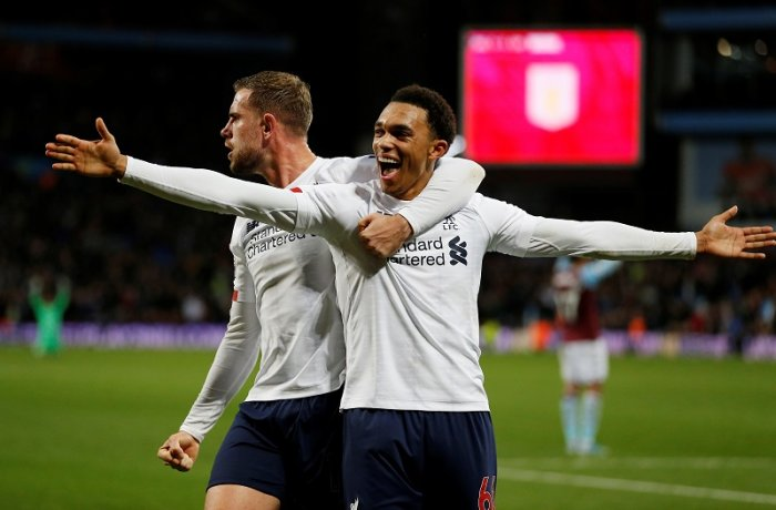 Liverpool's Jordan Henderson and Trent Alexander-Arnold celebrate their second goal scored by Sadio Mane. (Reuters Photo)