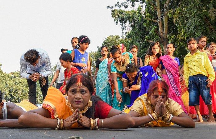 Devotees perform Chhath Puja at River Ganga in Kolkata. (PTI Photo)