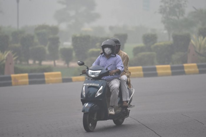 A motorcyclist rides through thick smog, in New Delhi, Sunday, Nov. 3, 2019. Delhi was enveloped in a thick layer of smog on Sunday morning with the minimum temperature settling at 18.7 degrees Celsius, four notches above the season's average. PTI