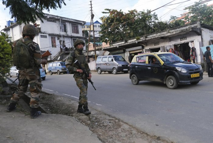 Soldiers stand guard on a street in Kohima, capital of the northeastern Indian state of Nagaland (PTI Photo)