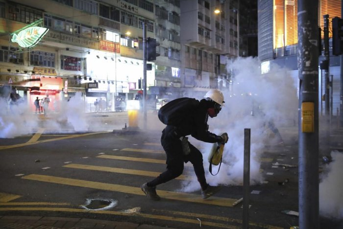 A demonstrator reacts as police fire tear gas during a protest in Hong Kong (AP/PTI Photo)