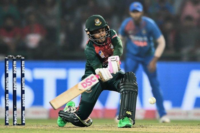 Bangladesh's Mushfiqur Rahim plays a shot during the first T20 international cricket match of a three-match series between Bangladesh and India, at Arun Jaitley Cricket Stadium in New Delhi. (AFP Photo)