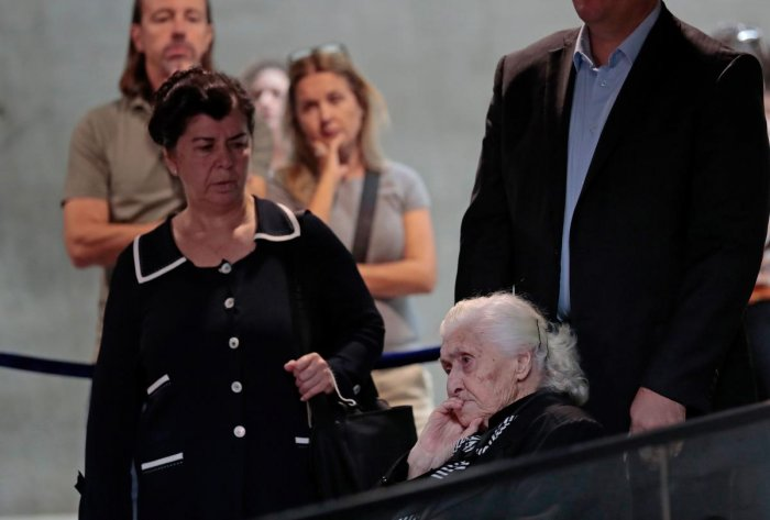 World War II rescuer Melpomeni Dina (R) waits to be reunited with holocaust survivors Yossi Mor and his sister Sarah Yanai (unseen) whom she helped escape in 1943, at the Hall of Names at the Yad Vashem Holocaust Memorial museum in Jerusalem on November 3, 2019. (Photo by EMMANUEL DUNAND / AFP)