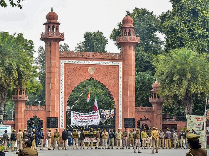 Police personnel deployed on the campus of Aligarh Muslim University. (PTI Photo)