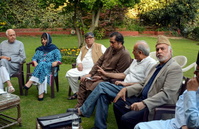 National Conference President Farooq Abdullah, PDP President and former chief minister Mehbooba Mufti and other leaders during an all party meeting regarding the current situation in Kashmir, in Srinagar. (PTI Photo)