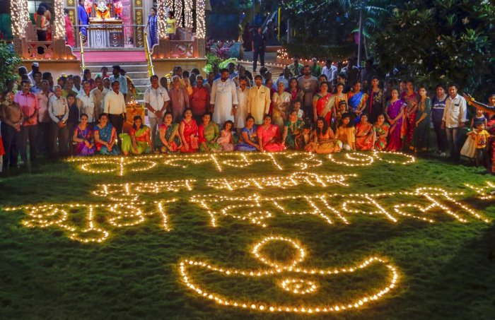 People light lamps to celebrate new Hindu calendar year (first day of Vikram Samvat 2076) in Thane, Monday night, Oct. 28, 2019. (PTI Photo)