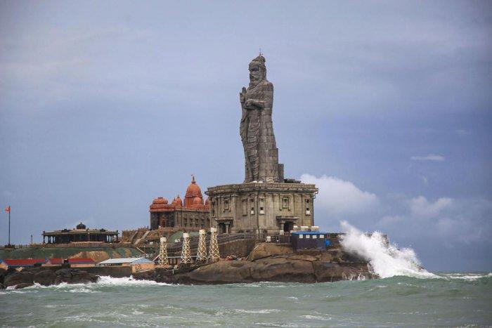 Sea waves break against the 133-ft tall Thiruvalluvar statue in Kanyakumari district of Tamil Nadu. (PTI Photo)