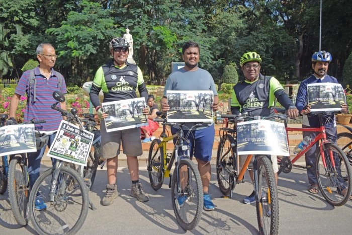 Cyclists joining in on the protest held by the Cubbon Park Walkers Association to save it from being destroyed by a concrete building that has been sanctioned by the Bangalore High Court. (DH Photo: Sneha Sengupta)