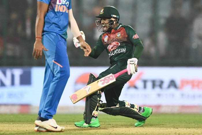 Bangladesh's Mushfiqur Rahim (R) celebrates his victory at the end of the first T20 international cricket match of a three-match series between Bangladesh and India, at Arun Jaitley Cricket Stadium in New Delhi on November 3, 2019. (Photo by AFP)