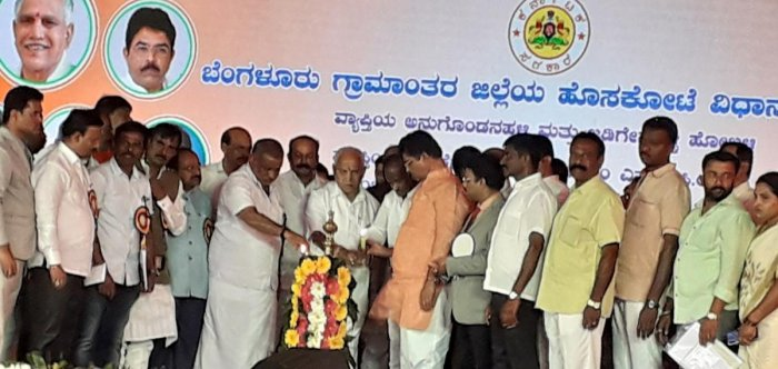 Chief Minister B S Yediyurappa launches development projects in Hoskote, Bengaluru Rural district on Monday. Ministers J C Madhuswamy, R Ashoka, disqualified MLA M T B Nagaraj and others were present.