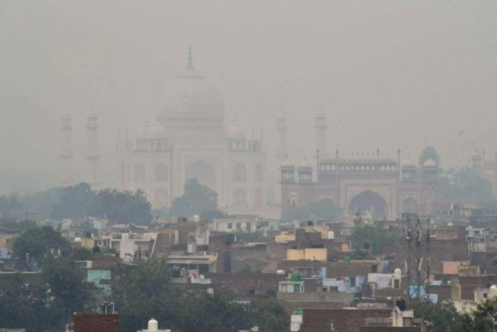A view of Agra city with the Taj Mahal shrouded in smog. PTI