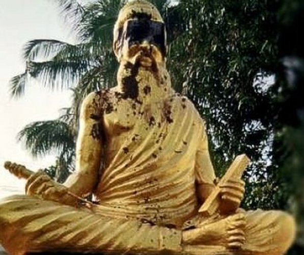 A statue of the Tamil saint-poet was smeared with cow dung in Thanjavur district. (Photo: Twitter)