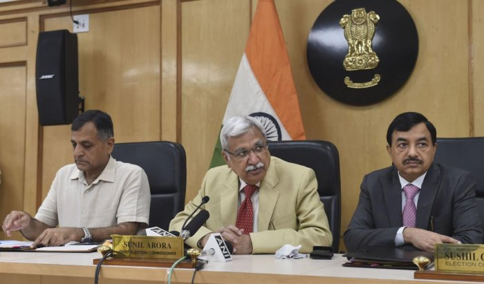Chief Election Commissioner Sunil Arora flanked by Election Commissioners Ashok Lavasa (L) and Sunil Chandra during a press conference regarding Maharashtra and Haryana Assembly Elections, at Election Commission in New Delhi. (PTI Photo)