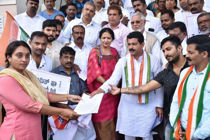 Congress leaders submit a memorandum to Additional Deputy Commissioner Dr Sneha on the premises of the DC's office in Madikeri on Monday.