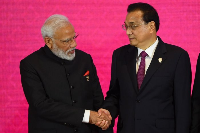 India's Prime Minister Narendra Modi shakes hands with China's Premier Li Keqiang during the 3rd Regional Comprehensive Economic Partnership (RCEP) Summit in Bangkok on November 4, 2019, on the sidelines of the 35th Association of Southeast Asian Nations