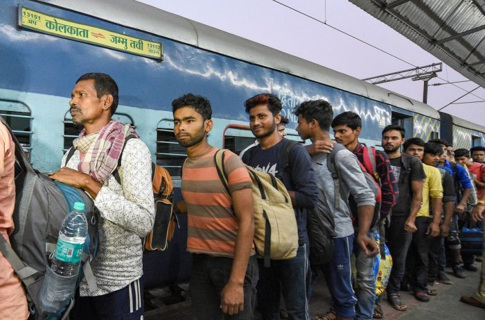 Workers arrive at the station from Jammu and Kashmir, in Kolkata. (PTI Photo)