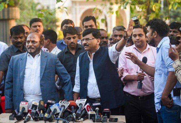 Shiv Sena leaders Ramdas Kadam and Sanjay Raut address the media after a meeting with Maharashtra Governor Bhagat Singh Koshyari in Mumbai, Monday, Nov. 4, 2019. (PTI Photo)