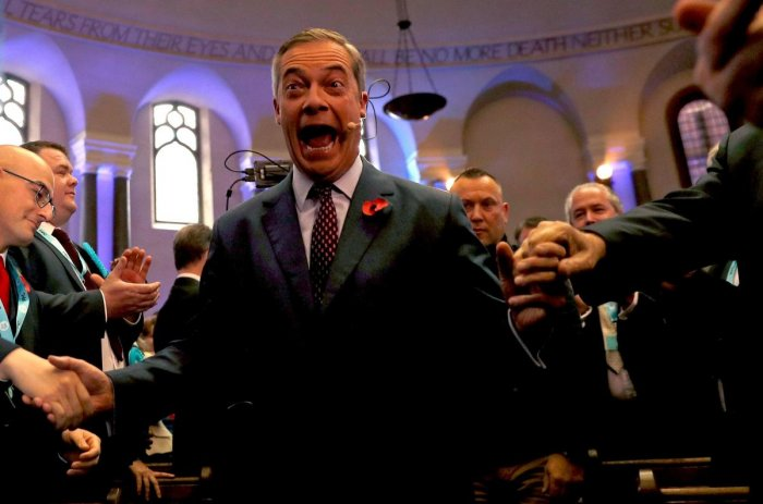 Brexit Party leader Nigel Farage (C) arrives to speak at an event to introduce the party's Prospective Parliamentary Candidates (PPC) for the 2019 general election in London on November 4, 2019. - Britain goes to the polls on December 12 to vote in a pre-Christmas general election. (Photo by AFP)