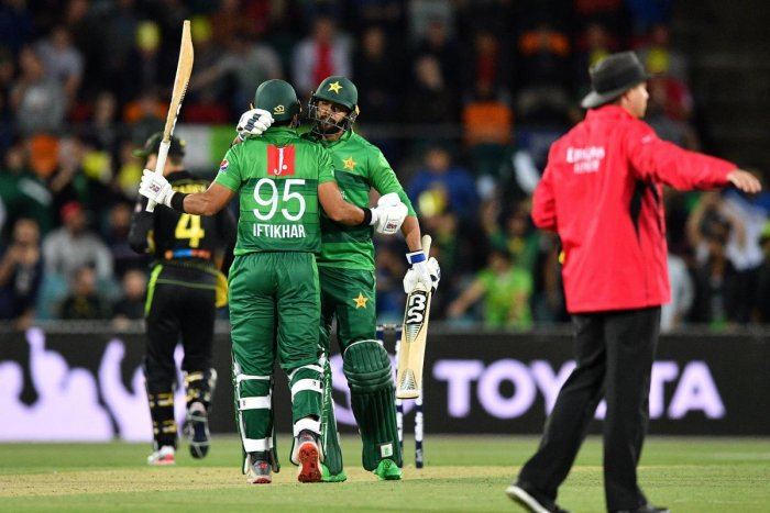 Pakistan's Imad Wasim (C) greets teammate Iftikhar Ahmed for his half century (50 runs) during the second Twenty20 match between Australia and Pakistan at the Manuka Oval in Canberra on November 5, 2019. (AFP)