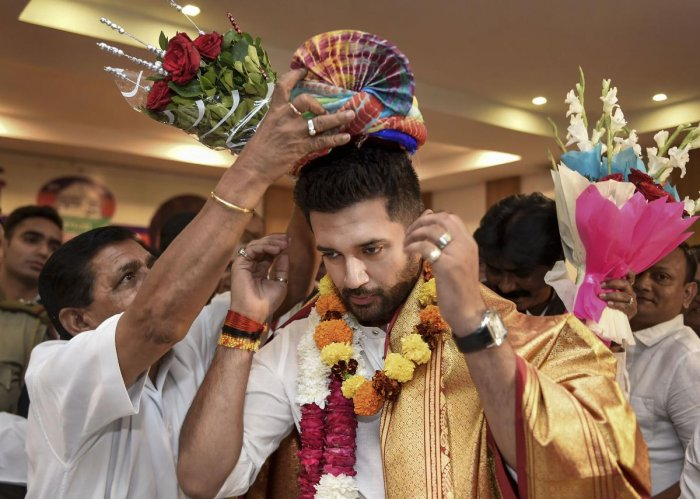 Newly-elected President of Lok Janshakti Party Chirag Paswan being felicitated, in New Delhi. (PTI Photo)