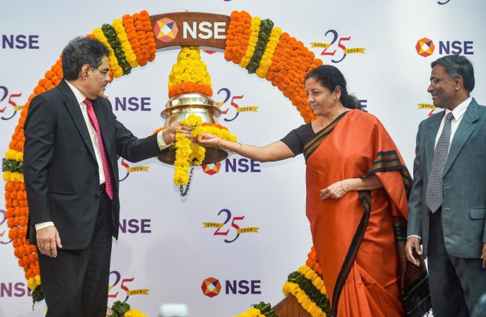 Union Finance Minister Nirmala Sitharaman and SEBI Chairman Ajay Tyagi ring a bell to conclude the Silver Jubilee celebrations of NSE, in Mumbai, Tuesday, Nov. 5, 2019. Also seen is National Stock Exchange MD & CEO Vikram Limaye. (PTI Photo)