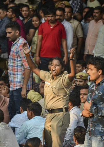A woman cop shouts slogans as police personnel gather outside the Delhi Police headquarters to protest against the repeated incidents of alleged violence against them by lawyers including the Tis Hazari Court clashes, in New Delhi. (PTI Photo)