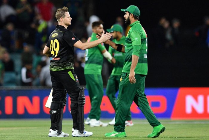 Steve Smith (L) of Australia shakes hands with Pakistan's Imad Wasim after the second Twenty20 match between Australia and Pakistan at the Manuka Oval in Canberra. AFP